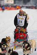 05 March 2006: Willow, Alaska - Paul Ellering, former professional wrestler, gets his team going after switching out his lead dog and being passed 3 minutes into the race during the restart of the 2006 Iditarod on Willow Lake in Willow, Alaska
