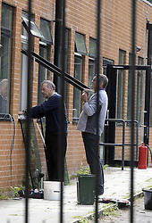 © Licensed to London News Pictures. 10/06/2013<br /> Workmen repairing a window at the back of the Darul Uloom Islamic school Chislehurst,Kent late this afternoon (10.06.2013)  after a suspicious fire.Police will be at the school 24/7.  Four teenagers have been arrested.<br /> Photo credit :Grant Falvey/LNP