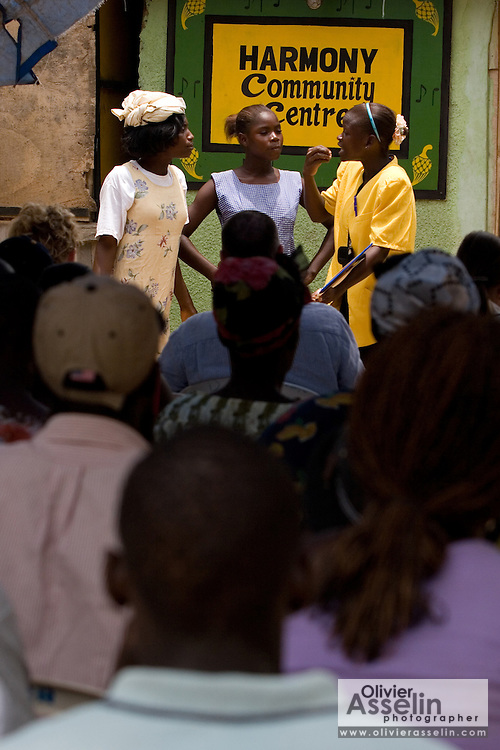 Members of the Harmony Community Centre perform a sketch on the importance of education in front of other members at the Buduburam refugee settlement, roughly 20 km west of Ghana's capital Accra on Friday April 13, 2007. The Buduburam refugee settlement is still home over 30,000 Liberians, most of which have mixed feelings about returning to Liberia. The Harmony Community Centre is aimed at helping people with mental and physical disabilities integrate with the community through art, music and theater performances..