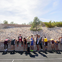 040315  Adron Gardner/Independent<br /> <br /> Runners recover against a wall after a boys running heat during the Ramah invitational at Ramah High School Friday.