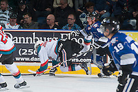 KELOWNA, CANADA - MARCH 11: Lucas Johansen #7 of Kelowna Rockets falls to the ice after a check by Bryton Sayer #8 of Victoria Royals on March 11, 2015 at Prospera Place in Kelowna, British Columbia, Canada.  (Photo by Marissa Baecker/Shoot the Breeze)  *** Local Caption *** Bryton Sayer; Lucas Johansen;