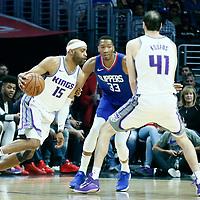 13 January 2018: Sacramento Kings guard Vince Carter (15) drives past LA Clippers forward Wesley Johnson (33) on screen set by Sacramento Kings center Kosta Koufos (41) during the LA Clippers 126-105 victory over the Sacramento Kings, at the Staples Center, Los Angeles, California, USA.