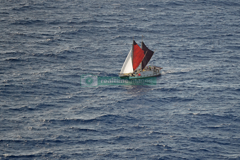 June 16, 2017 - Oahu, HI, United States of America - The Polynesian double-hulled voyaging canoe, HokuleÊ»a, approaches Oahu after sailing 40,000 nautical miles around the world during a 36-month journey June 16, 2017 in Hawaii. The Hokulea is a full-scale replica of an ancient Polynesian double-hulled voyaging canoe built to prove the theory that Polynesian people traveled great distances by boat throughout history. (Credit Image: © Tara Molle/Planet Pix via ZUMA Wire)