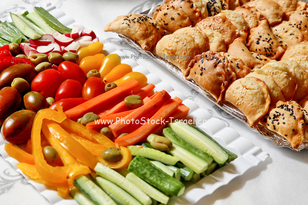 Cut vegetable snacks and finger pastries