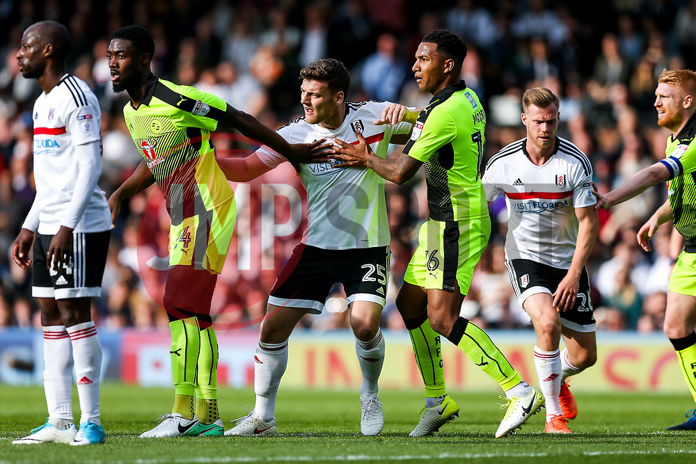 Chris Martin of Fulham is held by Tyler Blackett and Liam Moore of Reading - Rogan Thomson/JMP - 13/05/2017 - FOOTBALL - Craven Cottage - London, England - Fulham v Reading - Sky Bet EFL Championship Play-Off Semi Final 1st Leg.