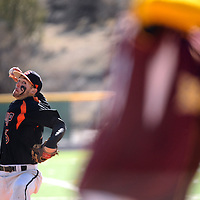 040114  Adron Gardner<br /> <br /> Gallup Bengal Nick Romero (6) winds a pitch to a Belen Eagle at Ford Canyon Park in Gallup Tuesday.