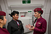 Qatar Airways cabin crew in an Airbus A350-1000 at the Farnborough Airshow, on 18th July 2018, in Farnborough, England.