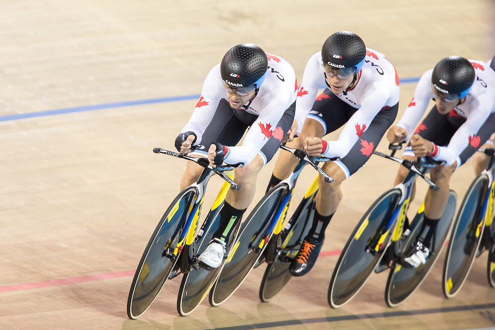 The Canadian team of (L-R) Rémi Pelletier, Sean Mackinnon, Adam Jamiesonand Eric Johnstone race in the 1st round of the men's cycling team pursuit  at the 2015 Pan American Games in Toronto, Canada, July 18,  2015.  AFP PHOTO/GEOFF ROBINS