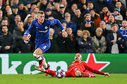 YELLOW CARD Bayern Munich midfielder Thiago Alcántara (6) fouls Chelsea midfielder Ross Barkley (8) during the Champions League match between Chelsea and Bayern Munich at Stamford Bridge, London, England on 25 February 2020.
