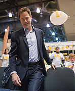 © Licensed to London News Pictures. 14/03/2015. Liverpool, UK.  Deputy Prime Minister and Leader of the Liberal Democrats Nick Clegg pats a campaign balloon away before phone canvassing the conference centre. The Liberal Democrat Spring Conference in Liverpool 14th March 2015. Photo credit : Stephen Simpson/LNP
