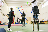 """NAPLES, ITALY - 16 MARCH 2018: Vice-President of """"Il Tappeto di Iqbal"""" Marco Riccio (25) juggles with a teenagers during the circus activity at """"Il Tappeto di Iqbal"""" (Iqbal's carpet), a non-profit cooperative in Barra, the estern district of Naples, Italy, on March 16th 2018.<br /> <br /> Il Tappeto di Iqbal (Iqbal's Carpet) is a non-profit cooperative founded in 2015 and Save The Children partner since 2015 that operates in the Naple's eastern neighborhood of Barra children in the arts of circus, theater and parkour. It was named after Iqbal Masih, a Pakistani boy who escaped from life as a child slave and became an activist against bonded labor in the 1990s.<br /> Barra, which is home to some 45,000 people, has the highest rate of school dropouts in the Italian region of Campania. Once a thriving industrial community, many of the factories were destroyed in a 1980 earthquake and never rebuilt. The resulting de-industrialization turned Barra into a poor, decaying neighborhood. There are no cinemas, theaters, parks or public spaces in Barra.<br /> The vast majority of children from poor families are faced with the choice of working in the black economy or joining the ranks of the organised crime.<br /> Recently, Save the Children Italy opened a number of educational and social spaces in Barra. The centers, known as Punti Luce, or points of light, aim to help local kids stay out of the ranks of the organised crime and have also become hubs for Iqbal's Carpet to work."""