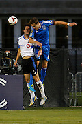 Montreal Impact defender Jeb Brovsky (5) and San Jose Earthquakes defender Clarence Goodson (44) battle in the air during the first half of play at Buck Shaw Stadium in Santa Clara, California, on September 17, 2013. (Stan Olszewski/QMI Agency)