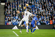 Leicester City Goalkeeper Kasper Schmeichel (1) juggles this cross under close attention from Burnley's Sam Vokes during the Premier League match between Leicester City and Burnley at the King Power Stadium, Leicester, England on 10 November 2018.