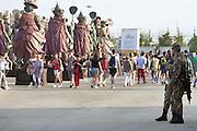 Soldiers in security service near Triulza west entrance to Expo 2015, Rho-Pero, Milan, July 2015. In the background the statues of People's Food. &copy; Carlo Cerchioli <br /> <br /> Militari in servizio di sicurezza nei pressi dell'ingresso ovest Triulza a Expo 2015, Rho-Pero, Milano, luglio 2015. Sullo sfondo le staue del Popolo del cibo