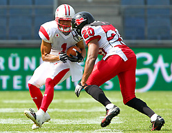 13.07.2011, UPC Arena, Graz, AUT, American Football WM 2011, Group B, Japan (JAP) vs Canada (CAN), im Bild Noriaki Kinoshita (Japan, #1, WR) and Sammy Okpro (Canada, #20, DB)  // during the American Football World Championship 2011 Group B game, Japan vs Canada, at UPC Arena, Graz, 2011-07-13, EXPA Pictures © 2011, PhotoCredit: EXPA/ T. Haumer