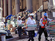 "Food and water are piled on the steps of St.Peters where trinity cemetery is and volunteers carry supplies in tto trinity church Friday  Sept.15,2001. Through my eyes and with my camera I am able to see the world we live in, and try to bring things into focus. Photography preserves my vision of what ""I see"" at a specific time and place- a moment. Creating a bond between  me and my subject and capturing and emotion for eternity. Having lived and worked in New York City for over 15 years when 911 happened. I had to go and ""see"" with my camera what lower Manhattan was like after this horrific attack on our Nation. The World Trade Center owned the skyline in lower Manhattan making it feel more like a canyon. After the Twin Towers fell, and I saw with my own eyes and camera the destruction, I realized what little land they actually sat on. The Twin Towers may not have occupied a large plot of land but they now touched everyones life. Photo©SuziAltman"