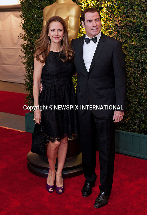 "JOHN TRAVOLTA AND WIFE KELLY PRESTON.attend the 2011 Governors Awards in the Grand Ballroom at Hollywood & Highland in Hollywood, Los Angeles_12/11/2011.Mandatory Photo Credit: ©Wawrychuk/Newspix International..              **ALL FEES PAYABLE TO: ""NEWSPIX INTERNATIONAL""**..PHOTO CREDIT MANDATORY!!: NEWSPIX INTERNATIONAL(Failure to credit will incur a surcharge of 100% of reproduction fees)..IMMEDIATE CONFIRMATION OF USAGE REQUIRED:.Newspix International, 31 Chinnery Hill, Bishop's Stortford, ENGLAND CM23 3PS.Tel:+441279 324672  ; Fax: +441279656877.Mobile:  0777568 1153.e-mail: info@newspixinternational.co.uk"