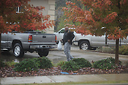 Law enforcement personnel investigate after Mechanics Bank on University Avenue in Oxford, Miss. was robbed on Tuesday, November 2, 2010.