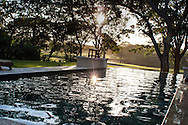 A private vacation home located along the Robert Trent Jones II golf course at the Reserva Conchal Resort. The pool is a relaxing and tranquil at sunset.