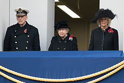 © Licensed to London News Pictures. 12/11/2017. London, UK.  The DUKE OF EDINBURGH, HRH QUEEN ELIZABETH II and CAMILLA DUCHESS OF CORNWALL attend a Day Ceremony at the Cenotaph war memorial in London, United Kingdom, on November 13, 2016 . Thousands of people honour the war dead by gathering at the iconic memorial to lay wreaths and observe two minutes silence. Photo credit: Ray Tang/LNP