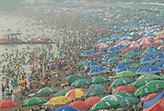 DALIAN, CHINA - AUGUST 16: (CHINA OUT) <br /> <br /> Crowds Cool Off At Fujiazhuang Beach<br /> <br /> Tourists crowd on to the Fujiazhuang beach to cool themselves as the temperature reaches 30 degrees on August 16, 2015 in Dalian, Liaoning Province of China.<br /> ©Exclusivepix Media