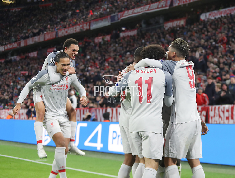 Liverpool players celebrates Sadio Mane's first goal during the Champions League round of 16, leg 2 of 2 match between Bayern Munich and Liverpool at the Allianz Arena stadium, Munich, Germany on 13 March 2019.