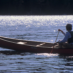 A man canoes on Echo Lake on the western side of Mount Desert Island in Maine's Acadia National Park.