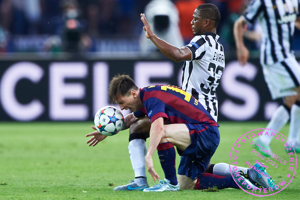 (L) Lionel Messi of FC Barcelona fights for the ball with (R) Patrice Evra from Juventus during the 2014/15 UEFA Champions League Final between Juventus and FC Barcelona at Olympiastadion on June 6, 2015 in Berlin, Germany.<br /> Germany, Berlin, June 6, 2015<br /> <br /> Picture also available in RAW (NEF) or TIFF format on special request.<br /> <br /> For editorial use only. Any commercial or promotional use requires permission.<br /> <br /> Adam Nurkiewicz declares that he has no rights to the image of people at the photographs of his authorship.<br /> <br /> Mandatory credit:<br /> Photo by &copy; Adam Nurkiewicz / Mediasport