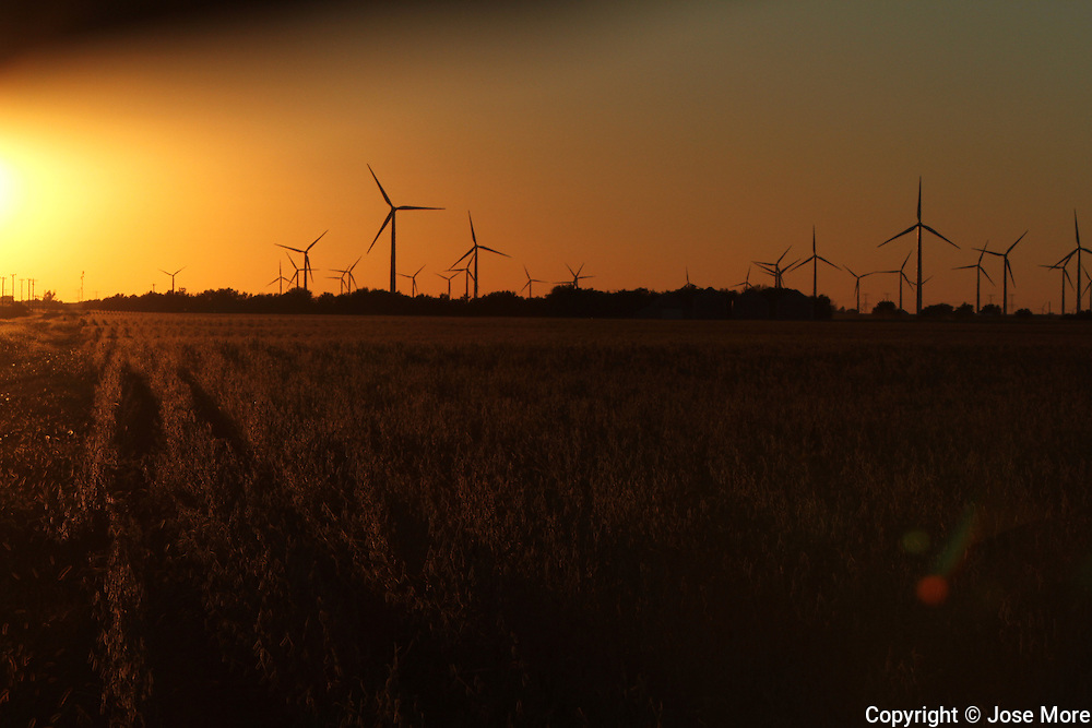Power generating wind farms at sunset near Dwight, in central Illinois. Available in Raw format.<br /> <br /> Photography by Jose More