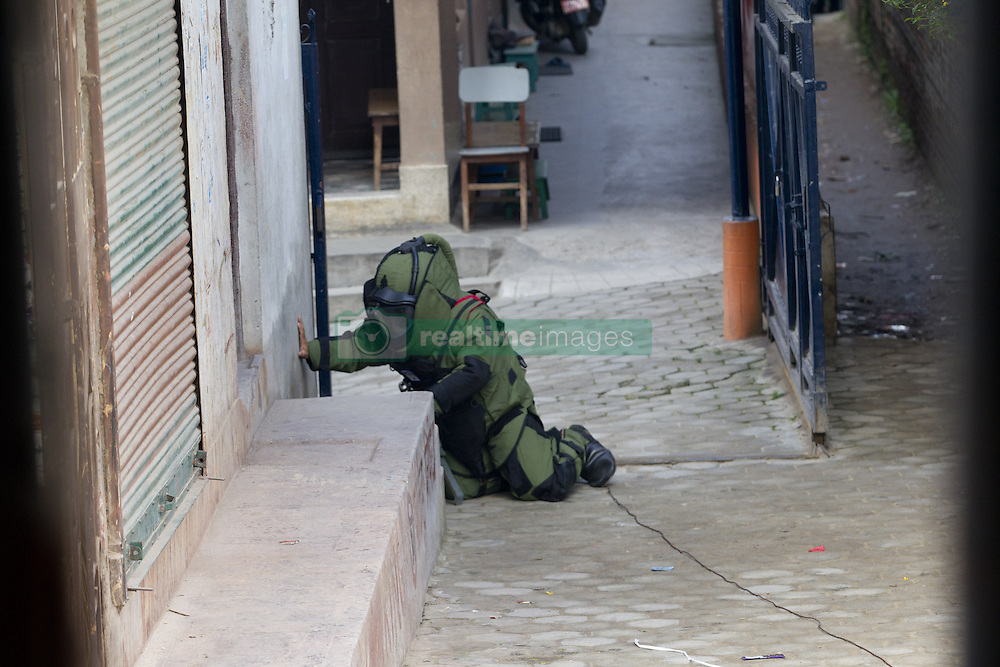 KATHMANDU, Sept. 20, 2016 (Xinhua) -- A member of a bomb disposal team works near a suspicious pressure cooker after a bomb scare outside the Kanchanjunga School in Kathmandu, Nepal, Sept. 20, 2016. The scare was found true and later it was disposed.In four different schools of Kathmandu unknown group kept the different kinds of bombs. (Xinhua/Pratap Thapa).****Authorized by ytfs* (Credit Image: © Pratap Thapa/Xinhua via ZUMA Wire)
