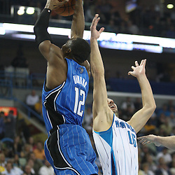 18 February 2009:Orlando Magic center Dwight Howard (12) grabs a rebound over New Orleans Hornets forward Peja Stojakovic (16) during a NBA basketball game between the Orlando Magic and the New Orleans Hornets at the New Orleans Arena in New Orleans, Louisiana.