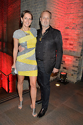 IAN WACE and his wife SAFFRON ALDRIDGE at a Night of Disco in aid of Save The Children held at The Roundhouse, Chalk Farm Road, London on 5th March 2015.