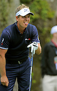 Luke Donald, of England, reacts after to his drive off the third tee during the final round of the RBC Heritage golf tournament in Hilton Head Island, S.C., Sunday, April 20, 2014. (AP Photo/Stephen B. Morton)