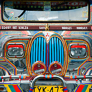 MANILA (Philippines). 2009. Jeepney in Makati, Manila. Jeepneys were originally made from US military jeeps left over from the WWII. Nowadays are the most popular means of public transportation in the Philippines and also become a symbol of Philippine culture..