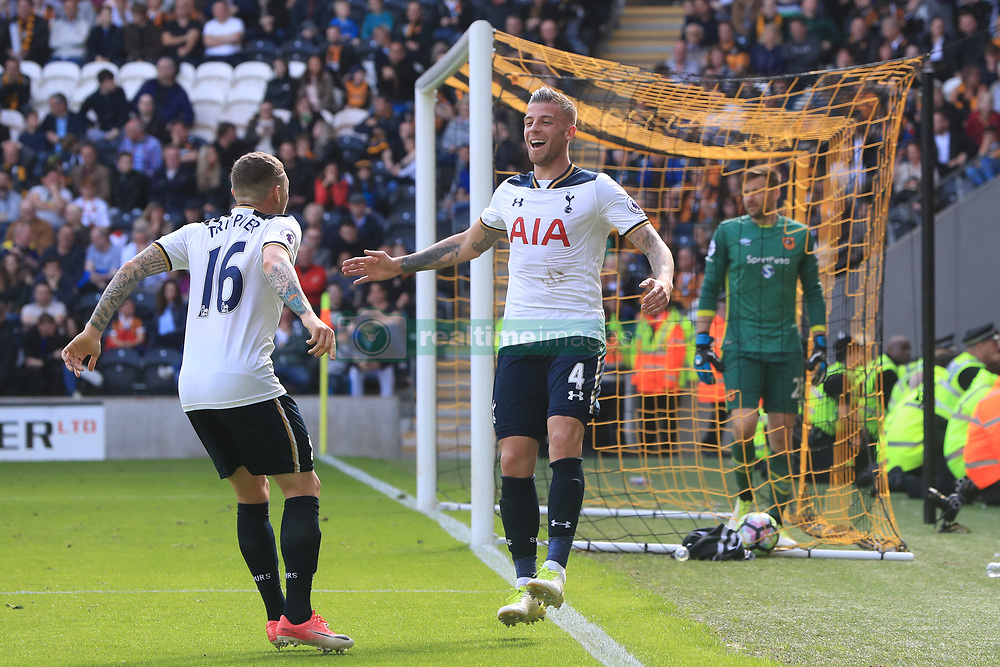 Tottenham Hotspur's Toby Alderweireld (right) celebrates scoring his side's seventh goal of the game during the Premier League match at the KCOM Stadium, Hull.