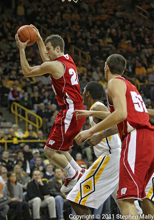 February 09 2011: Wisconsin Badgers guard/forward Tim Jarmusz (24) grabs a rebound during the first half of an NCAA college basketball game at Carver-Hawkeye Arena in Iowa City, Iowa on February 9, 2011. Wisconsin defeated Iowa 62-59.