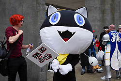 © Licensed to London News Pictures. 28/05/2017. London, UK. A girl dressed as Morgana from Persona 5 at MCM Comic Con taking place at Excel in East London.  The three day event celebrates popular comic books, anime, games, television and movies.  Many attendees take the opportunity to dress as their favourite characters.    Photo credit : Stephen Chung/LNP