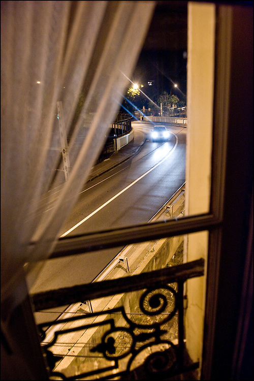 A car is seen from a window at night in Sèvres, outskirt of Paris.