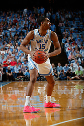 CHAPEL HILL, NC - FEBRUARY 05: Garrison Brooks #15 of the North Carolina Tar Heels carries the ball during a game against the North Carolina State Wolfpack on February 05, 2019 at the Dean Smith Center in Chapel Hill, North Carolina. North Carolina won 113-96. North Carolina wore retro uniforms to honor the 50th anniversary of the 1967-69 team. (Photo by Peyton Williams/UNC/Getty Images) *** Local Caption *** Garrison Brooks