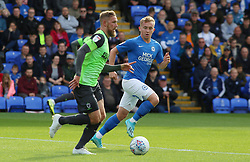 Scott Wagstaff of AFC Wimbledon in action with Louis Reed of Peterborough United - Mandatory by-line: Joe Dent/JMP - 28/09/2019 - FOOTBALL - Weston Homes Stadium - Peterborough, England - Peterborough United v AFC Wimbledon - Sky Bet League One