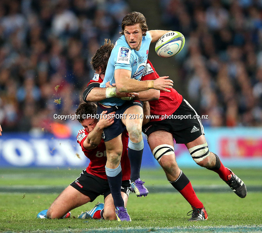 Rob Horne tackled by Tom Taylor<br /> Super Rugby Final, Waratahs v Crusaders, Sydney, Australia. ANZ Stadium. Saturday 2 August 2014. Photo: Paul Seiser/PHOTOSPORT