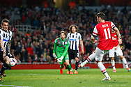 Mesut Ozil of Arsenal (right) scores his team's second goal during the Barclays Premier League match at the Emirates Stadium, London<br /> Picture by David Horn/Focus Images Ltd +44 7545 970036<br /> 28/04/2014