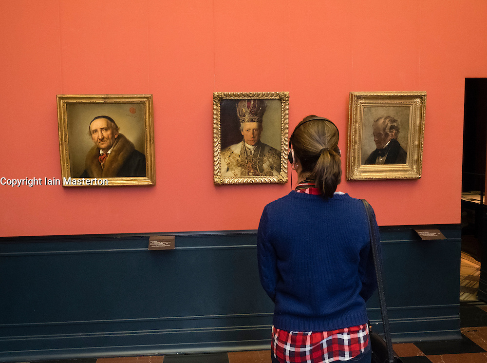 Woman looking at painting by Friedrich von Amerling , Kaiser Franz I of Austria at Alte Nationalgalerie in Berlin Germany
