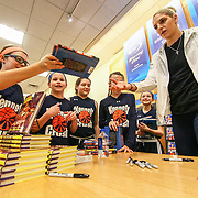 The Kennett Crush Players Olivia O'Hara (11), Bridget Mcmanamon (11), Emily O'Hara (11), Quinn Simmons (10) and Ellie C, Soriano (10) watch Elena Delle Donne prepare to sign their books Saturday, March 10, 2018, at Barnes and Noble in Wilmington Delaware.