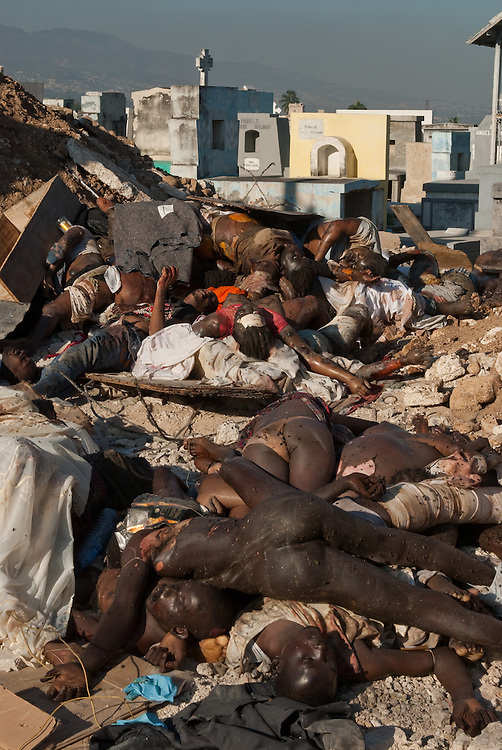 1/16/10 9:08:51 AM -- Port-Au-Prince, Haiti. -- Daily coverage of the aftermath of the 7.0 earthquake in Haiti -- Victims of Tuesday's 7.0 earthquake lie on the street outside the National Cemetery, Saturday, Jan. 16, 2010 in Port au Prince, Haiti. (Photo by William B.  Plowman ©)