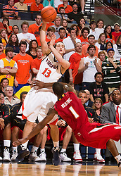 Virginia guard Sammy Zeglinski (13) is defended by Maryland forward Landon Milbourne (1).  The Virginia Cavaliers defeated the Maryland Terrapins 68-63 at the John Paul Jones Arena on the Grounds of the University of Virginia in Charlottesville, VA on March 7, 2009.