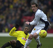 28/02/2004  -  Nationwide Div 1 Watford v Wimbledon.Watford's Micah Hyde [grounded], watches as his pass goes past Wimbledon's Peter Hawkins.