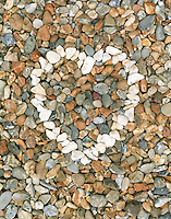 Pebbles stones heart (close-up)
