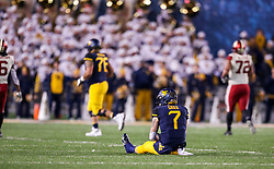 Nov 23, 2018; Morgantown, WV, USA; West Virginia Mountaineers quarterback Will Grier (7) reacts after a turnover during the fourth quarter against the Oklahoma Sooners at Mountaineer Field at Milan Puskar Stadium. Mandatory Credit: Ben Queen-USA TODAY Sports