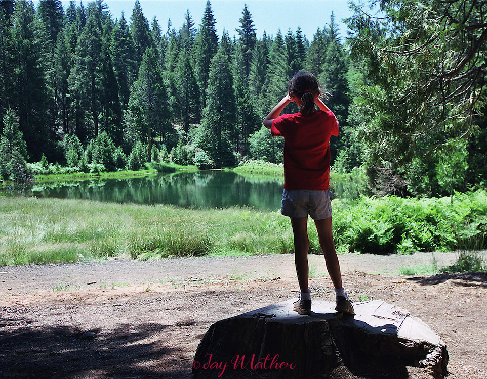 A camper surveys the lake at Camp Menzies Girl Scout camp near Arnold, CA at the beginning of an eight-day stay.  During that time nearly 120 girls attending the camp will make new friends, experience new activities and have a memory for life.  June 27, 2000.